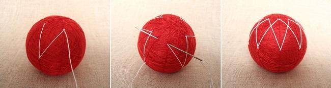 Продевание белой нити через красный шар